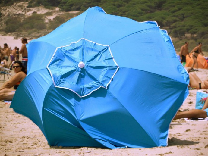 blue umbrella beach tarifa wind
