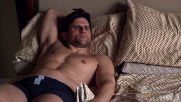 Kyle Dean Massey shirtless on bed