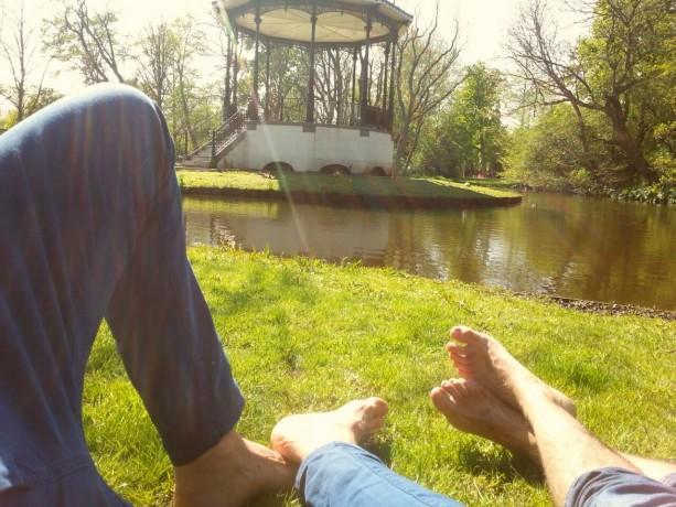 two feet in green park in Amsterdam Vondelpark