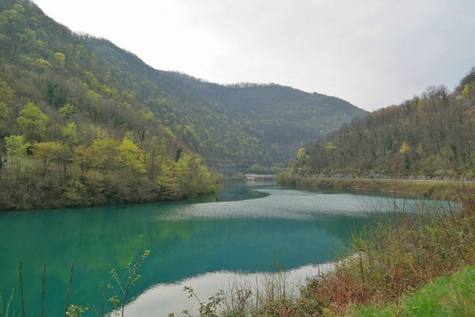 soca-valley-blue-river-with-hills-slovenia-gay-travel