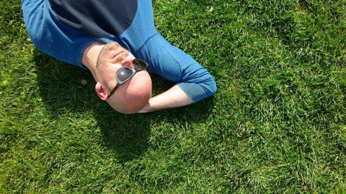 live like tom relaxing in grass gay travel oslo city break
