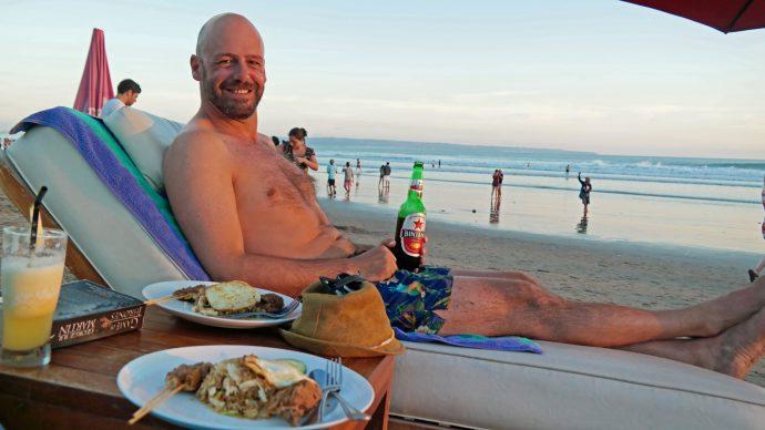 man on beach seminyak bali