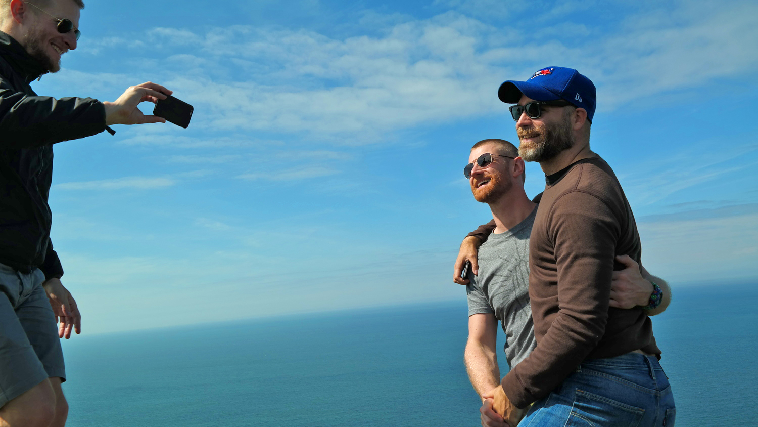 gay couple during gay hiking taking picture