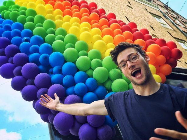 nerdy gay guy sexy glasses rainbow balloons
