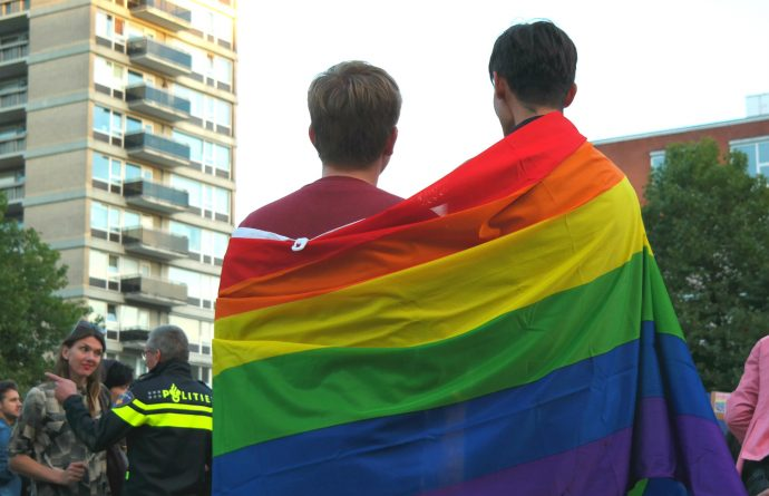 two boys with rainbow flag during Rotterdam Pride