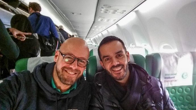 Scruffy gay couple travels with airplane to Gran Canaria