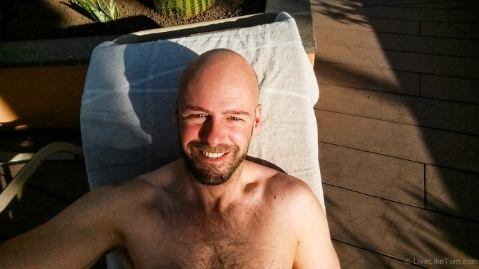 LiveLikeTom travel blogger on luxury travel sunbed selfie